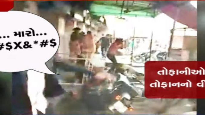 On cam; Protester provoking others to hurl stones at police in Ahmedabad's Shah Alam area, yesterday