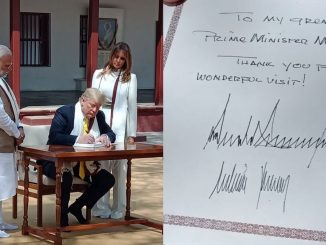 US President Donald Trump writes a message in the visitors' book at the Sabarmati Ashram Jano trump Ae Gandhi Asharam ni visitor