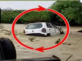 Hyderabad Car swept away in flash floods 2 rescued 1 missing
