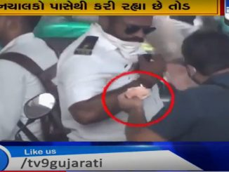 Viral video shows traffic police accepting money from offenders in Surat