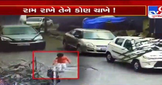 Mumbai: In a shocking incident,kid suffered only minor injuries after car ran over him while playing