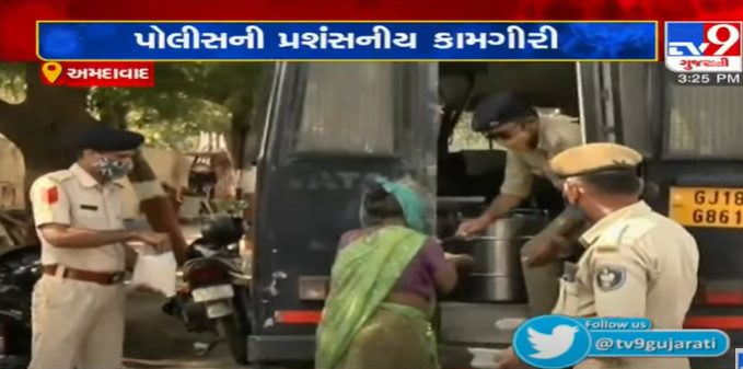 Humanity at its best Police distributing food packets to needy Ahmedabad
